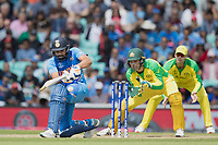 Rohit Sharma (India) sweeps to square leg during India vs Australia, ICC World Cup Cricket at The Oval on 9th June 2019