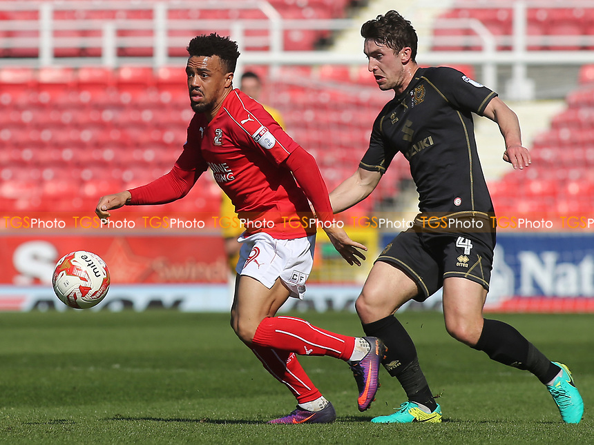 Nicky Ajose of Swindon shields the ball from MK Dons Joe Walsh during Swindon Town vs MK Dons, Sky Bet EFL League 1 Football at the County Ground on 8th April 2017