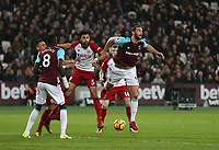 West Ham United's Andy Carroll flicks the ball on under pressure from West Bromwich Albion's Claudio Yacob<br /> <br /> Photographer Rob Newell/CameraSport<br /> <br /> The Premier League - West Ham United v West Bromwich Albion - Tuesday 2nd January 2018 - London Stadium - London<br /> <br /> World Copyright &copy; 2018 CameraSport. All rights reserved. 43 Linden Ave. Countesthorpe. Leicester. England. LE8 5PG - Tel: +44 (0) 116 277 4147 - admin@camerasport.com - www.camerasport.com