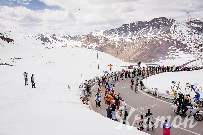 race leaders coming up the Passo dello Stelvio (alt: 2758m) through the snow<br /> <br /> Stage 16: Rovett &rsaquo; Bormio (222km)<br /> 100th Giro d'Italia 2017