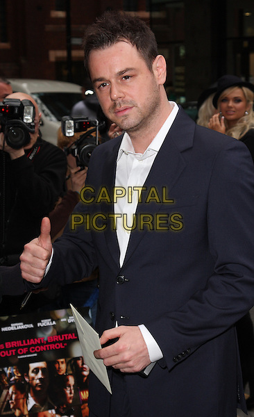DANNY DYER .Attending UK Film Premiere of 'Pimp' at Odeon Covent Garden, London, England, May 19th 2010..arrivals half length black suit jacket shirt white hand thumb stubble facial hair up gesture navy blue .CAP/ROS.©Steve Ross/Capital Pictures.
