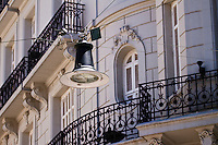 A street light rests suspended over the cobblestone intersection of Defensa and Moreno in the San Telmo Barrio of Buenos Aires, Argentina.