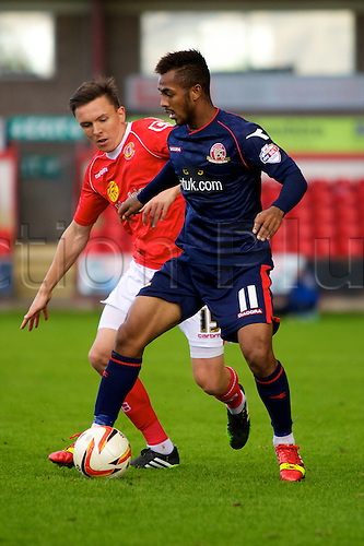 14.09.2013 Crewe, England. Walsall FC Ashley Hemmings and Crewe Alexandra defender Gregor Robertson in action during the League One game between Crewe Alexandra and Walsall FC from the Alexandra Stadium