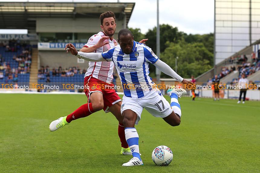Kyel Reid of Colchester United and Chris Whelpdale of Stevenage during Colchester United vs Stevenage, Sky Bet EFL League 2 Football at the Weston Homes Community Stadium on 12th August 2017