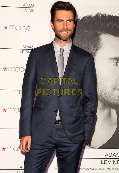 Adam Levine.Adam Levine attends the launch of his debut fragrance, Adam Levine, at Macy's.Century City on February 7, 2013 in Los Angeles, CA, USA, 7th February 2013..half length hand in pocket beard facial hair smiling tanned silver tie grey gray shirt blue navy suit .CAP/ADM/ES.©Emiley Schweich/AdMedia/Capital Pictures.
