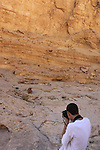 Israel, Negev, a boy and his dog in Nekarot Horseshoe