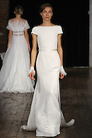 """Model walks runway in a """"Timeless"""" bridal gown from the Rivini by Rita Vinieris Fall 2017 collection on October 7th, 2016 during New York Bridal Fashion Week."""