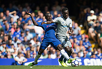 Ngolo Kante of Chelsea battles Idrissa Gueye of Everton during the Premier League match between Chelsea and Everton at Stamford Bridge, London, England on 27 August 2017. Photo by Andy Rowland.