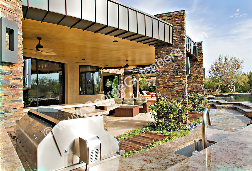 Outdoor BBQ area of luxury modern home