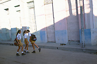 10 FEB 2003 - SANTA CLARA, CUBA - Schoolgirls play on their way to school. (PHOTO (C) NIGEL FARROW)