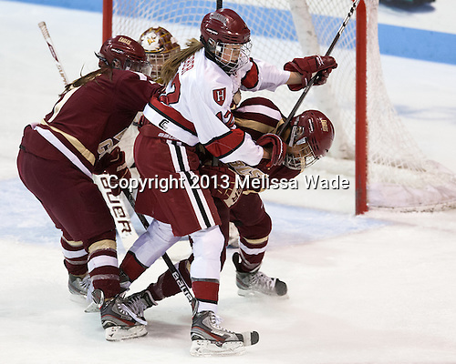 Dru Burns (BC - 7), Samantha Reber (Harvard - 12), Kaliya Johnson (BC - 6) - The Boston College Eagles defeated the Harvard University Crimson 2-1 in the 2013 Beanpot opening round on Tuesday, February 5, 2013, at Matthews Arena in Boston, Massachusetts.