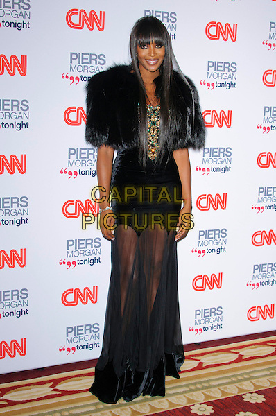 NAOMI CAMPBELL.The launch of CNN's 'Piers Morgan Tonight' at the Mandarin Oriental Hotel, London, England..December 7th, 2010.full length black fur shrug maxi dress sheer see thru through cape velvet trim .CAP/CJ.©Chris Joseph/Capital Pictures.