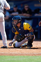 Michigan Wolverines catcher Marcus Chavez (12) checks the runner during a game against Army West Point on February 17, 2018 at Tradition Field in St. Lucie, Florida.  Army defeated Michigan 4-3.  (Mike Janes/Four Seam Images)