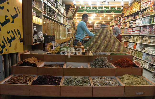 A Palestinian man sells spices at the main market in Jerusalem's old city, on Feb. 12, 2013. Photo by Mahfouz Abu Turk