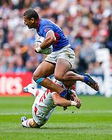 Samoa Outside Centre Paul Perez is tackled by Japan Winger Akihito Yamada - Mandatory byline: Rogan Thomson - 03/10/2015 - RUGBY UNION - Stadium:mk - Milton Keynes, England - Samoa v Japan - Rugby World Cup 2015 Pool B.