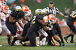 Clemson Tigers running back Adam Choice (26) is wrapped up by Tyler Williams (72) and Traveon Redd (17) of the Wake Forest Demon Deacons during second half action at BB&T Field on October 6, 2018 in Winston-Salem, North Carolina. the Tigers defeated the Demon Deacons 63-3. (Brian Westerholt/Sports On Film)