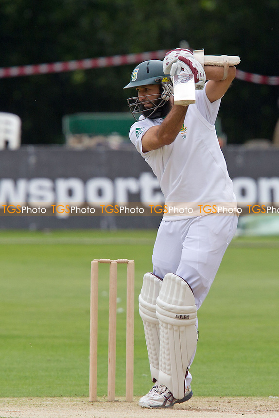 Hashim Amla, South Africa punches through point for a boundary - Kent CCC vs South Africa - Tourist Match Cricket at The St Lawrence Ground, Canterbury - 14/07/12 - MANDATORY CREDIT: Ray Lawrence/TGSPHOTO - Self billing applies where appropriate - 0845 094 6026 - contact@tgsphoto.co.uk - NO UNPAID USE.