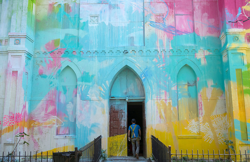 "Atlanta-based artist Alex Brewer, known as ""Hense,"" paints a mural over the exterior of an empty church at Delaware Ave. SW & H St. SW, in collaboration with the art gallery, ""Art Whino."" It will be completed next weekend for a showing and reception."