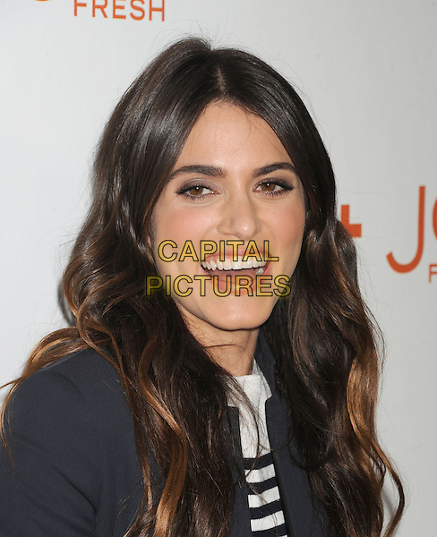 Nikki Reed.arriving at the Joe Fresh at JCP launch event at Joe Fresh at JCP Pop Up in West Hollywood, California, USA, .March 7th 2013. .portrait headshot smiling white striped  black jacket mouth open .CAP/ROT/TM.©Tony Michaels/Roth Stock/Capital Pictures