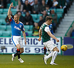 Paul Hanlon handles in the box but ref sees no penalty. Kenny Miller alerts him to his mistake