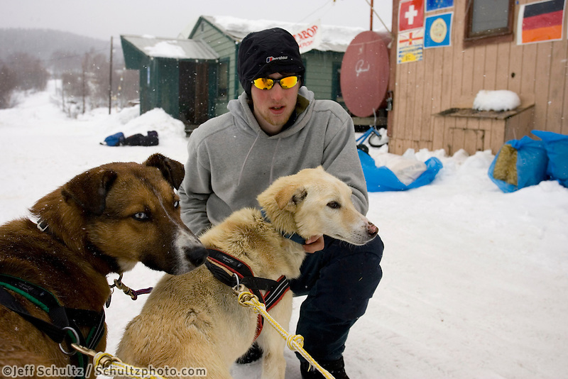 Volunteer Holds Bryan Mills Sled Dog Team @ Takotna Chkpt Iditarod 2005