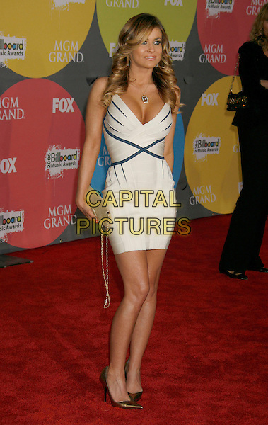 CARMEN ELECTRA.2006 Billboard Music Awards held at the MGM Grand Hotel and Casino, Las Vegas, Nevada, USA..December 4th, 2006.full length white dress blue stripes gold bag purse.CAP/ADM/RE.©Russ Elliot/AdMedia/Capital Pictures