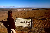tourist observes Halema`uma`u Crater at Hawaii, USAan Volcano Observatory, Kilauea Caldera, Hawaii, USA Volcanoes National Park, Big Island, Hawaii, USA