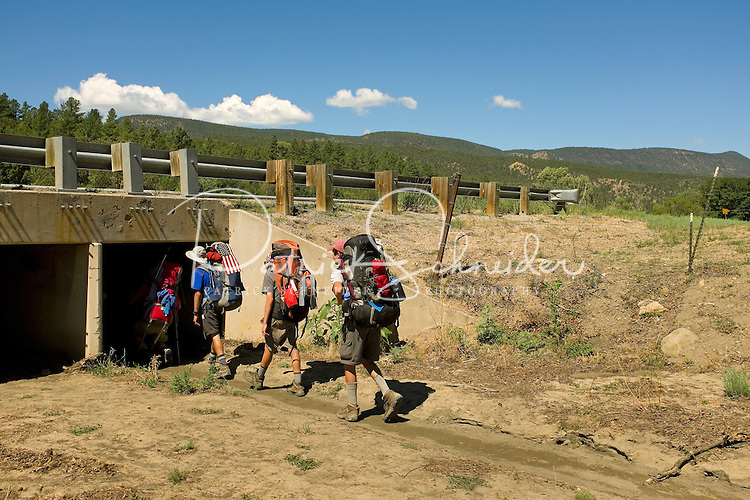 Photo story of Philmont Scout Ranch in Cimarron, New Mexico, taken during a Boy Scout Troop backpack trip in the summer of 2013. Photo is part of a comprehensive picture package which shows in-depth photography of a BSA Ventures crew on a trek.  In this photo BSA Venture Crew Scouts make their way under a tunnel passing under  highway in the backcountry at Philmont Scout Ranch.   <br /> <br /> The  Photo by travel photograph: PatrickschneiderPhoto.com