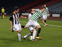Patrik Twarzdik tackled between Declan O'Kane (left) and Allan Smith in the Dunfermline Athletic v Celtic Scottish Football Association Youth Cup Final match played at Hampden Park, Glasgow on 1.5.13. ..