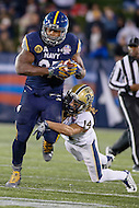 Annapolis, MD - December 28, 2015:    Pittsburgh Panthers defensive back Avonte Maddox (14) tries to tackle Navy Midshipmen fullback Chris Swain (37) during the Military Bowl game between Pitt vs Navy at Navy-Marine Corps Memorial Stadium in Annapolis, MD. (Photo by Elliott Brown/Media Images International)