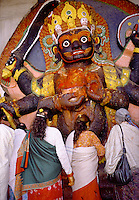 Black Bhairab statue and worshippers Durbar Square Kathmandu Nepal.