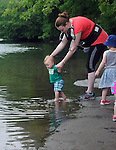 Landon Wilens, decides to wade in the water, as the hikers gather on a bank of the Esopus Creek, during a Hike It Baby/ Catskills-Woodstock sponsored hike into the Esopus Bend Nature Preserve in Saugerties, NY, on Memorial Day Monday, May 30, 2016. Photo by Jim Peppler. Copyright Jim Peppler 2016.<br /> The hike was led by HIB.Catskill-Woodstock, Ambassador, Ann Peters, accompanied by her husband, John Peters, their daughter, Violet; HIB chapter co-Ambassador, Ali Troxell, with her daughter, Lucia; and Robin Willens, and her son, Landon. They entered at the Sterley Avenue entrance and walked thru to the landing area on the Esopus.