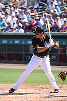 Derek Dietrich (32) of the Miami Marlins at bat during a Grapefruit League Spring Training game at the Roger Dean Complex on March 4, 2014 in Jupiter, Florida. Miami defeated Minnesota 3-1. (Stacy Jo Grant/Four Seam Images)