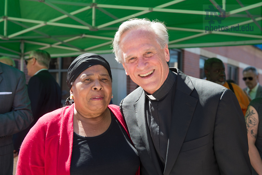 June 21, 2017; University of Notre Dame president Rev. John I. Jenkins, C.S.C., and a community member at the unveiling of the new sculpture of the Rev. Theodore M. Hesburgh and the Rev. Martin Luther King in downtown South Bend.  (Photo by Barbara Johnston/University of Notre Dame)