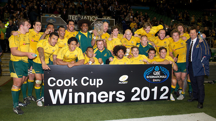 Robbie Deans, Australia Head Coach (far right), looks relieved after winning the Cook Cup between England and Australia, part of the QBE International series, at Twickenham on Saturday 17th November 2012 (Photo by Rob Munro)