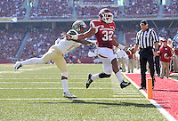 NWA Media/Michael Woods --10/25/2014-- w @NWAMICHAELW...University of Arkansas running back Jonathan Williams runs past University of Alabama Birmingham defender Jordan Petty to score a touchdown in the 2nd quarter of Saturday's game at Razorback Stadium in Fayetteville.