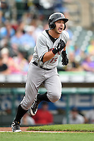 Indianapolis Indians third baseman Chase d'Arnaud (15) runs to first during a game against the Rochester Red Wings on July 26, 2014 at Frontier Field in Rochester, New  York.  Rochester defeated Indianapolis 1-0.  (Mike Janes/Four Seam Images)