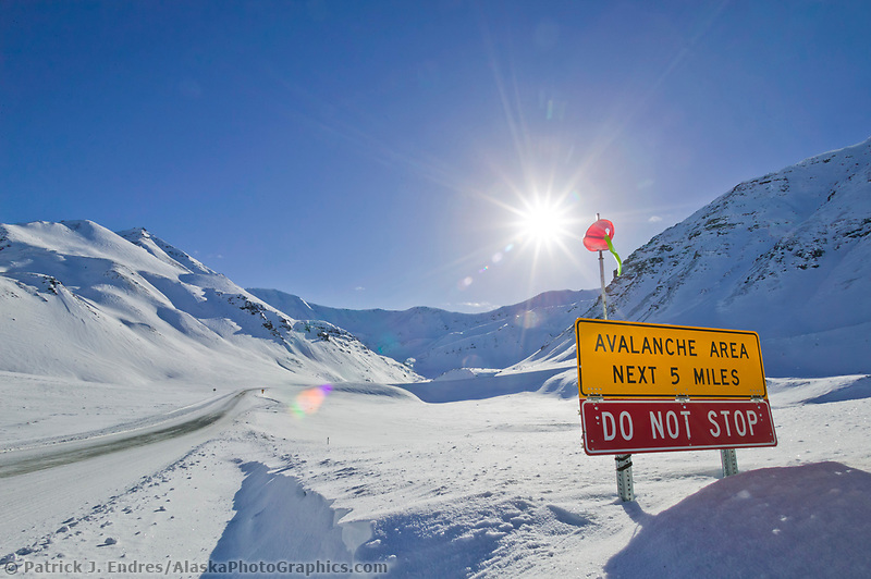 Avalanche warming sign at the base of atigun pass of the James Dalton Highway, Brooks Range, Alaska