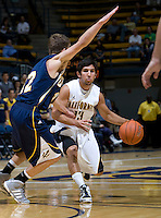 Raffi Chalian of California dribbles the ball during the game against San Diego at Haas Pavilion in Berkeley, California on November 1st, 2011.  California defeated San Diego, 88-53.