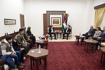 Palestinian President Mahmoud Abbas, meets with delegation from Iqra Academy for calculate mental intelligence, in the West Bank city of Ramallah, on January 2, 2020. Photo by Thaer Ganaim