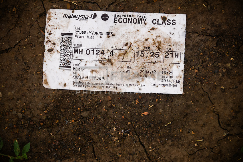 Boarding pass found on the crash site of flight MH17 Malaysian Airways Boeing 777, Hrabove, Eastern Ukraine.