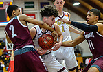 WEST HARTFORD, CT. 15 March 2018-031518BS22 - Zachary Francisco (33) from Sacred Heart battle for control of the ball against Corey McKeithan (2) and Kai Freitas (11) both from Windsor at the Div I semi-finals between Sacred Heart vs Windsor at University of Hartford on Thursday evening. Sacred Heart won in a thriller 59-58 over Windsor and advances to the finals at Mohegan Sun. Bill Shettle Republican-American