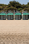 Green beach huts on the lido beach, Venice lagoon, Italy. May 2007.