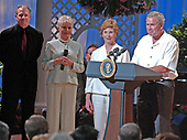 Washington, D.C. - June 15, 2005 -- United States President George w. Bush and first lady Laura Bush make remarks at the annual Congressional Picnic Performance on the South Lawn of the White House in Washington, D.C. on June 15, 2005. From left to right: Tom Wopat, Shirley Jones, Laura Bush, President Bush.<br /> Credit: Ron Sachs - Pool via CNP