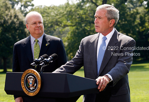 "Washington, D.C. - August 13, 2007 -- United States President George W. Bush makes remarks as he prepares to depart the White House for a vacation in Crawford, Texas after Deputy Chief of Staff Karl Rove announced on Monday, August 13, 2007 that he is leaving the Bush Administration at the end of August, 2007. Standing next to United States President George W. Bush, Rove told reporters ""I am grateful to have been a witness of history. It has been the joy and the honor of a lifetime."" Rove, a close friend of President Bush has been his most prominent advisor and political strategist..Credit: Aude Guerrucci - Pool via CNP"