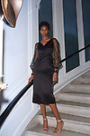 TK poses in a black satin slim dress with diamonte tulle sleeve, from the Barbara Tfank Fall Winter 2019 collection on February 13, 2019 at The Elizabeth Collective during New York Fashion Week.