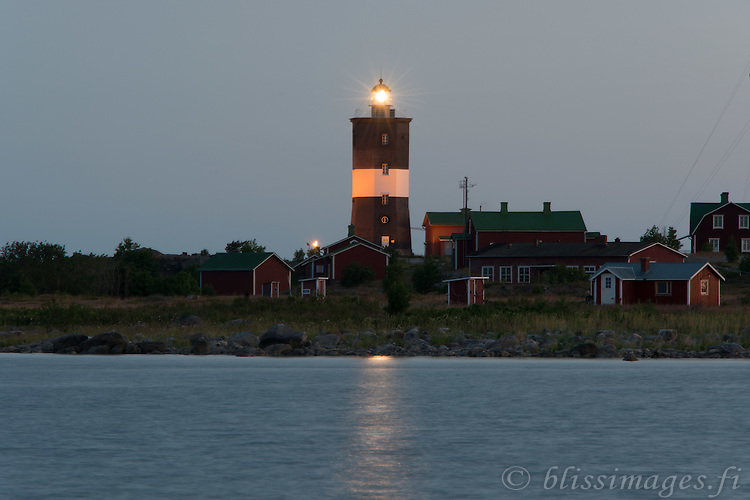 Norrskär light gleams at 1 am on a summer's night in the Gulf of Bothnia, Finland.
