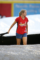 April 14, 2009:  A member of the Palm Beach Cardinals staff helps pull the tarp before a game at Roger Dean Stadium in Jupiter, FL.  Photo by:  Mike Janes/Four Seam Images