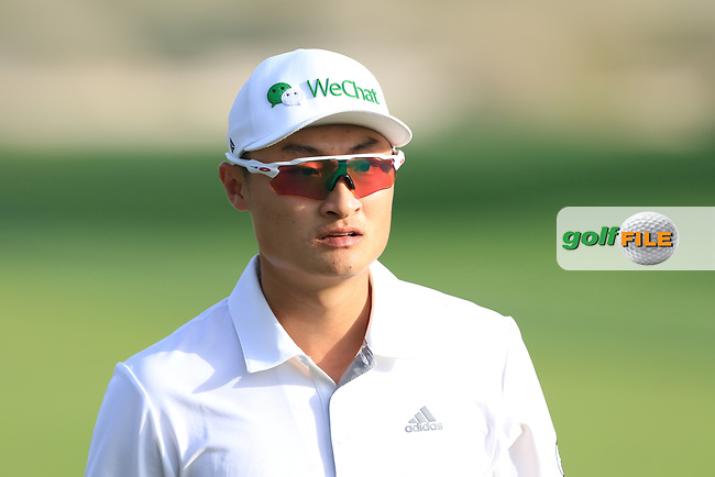 Haotong Li (CHN) on the 16th during Round 4 of the Omega Dubai Desert Classic, Emirates Golf Club, Dubai,  United Arab Emirates. 27/01/2019<br /> Picture: Golffile | Thos Caffrey<br /> <br /> <br /> All photo usage must carry mandatory copyright credit (© Golffile | Thos Caffrey)