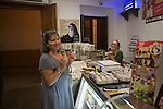 Woman eating ice cram in confectioners shop Ronda, Spain